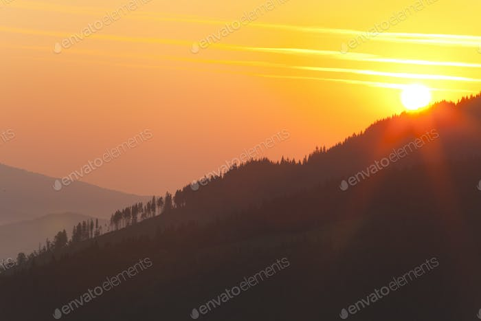 Sun at sunrise in the mountains