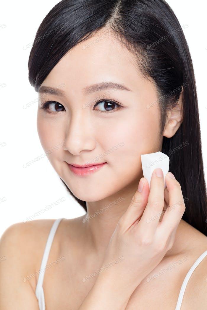 Beauty asian woman applying makeup with sponge powder puff