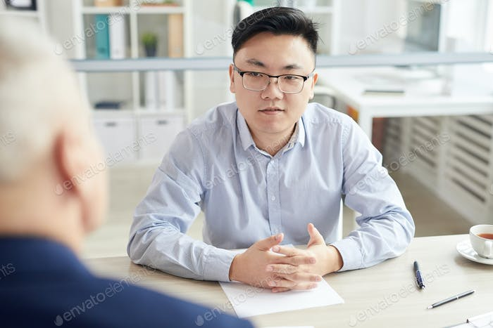 Asian Man at Job Interview