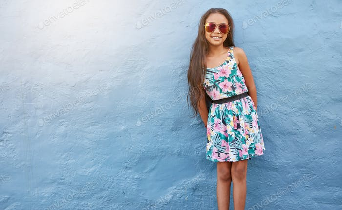 Adorable girl in beautiful dress and sunglasses
