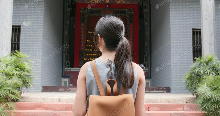 Travel woman taking video on camera in the chinese building