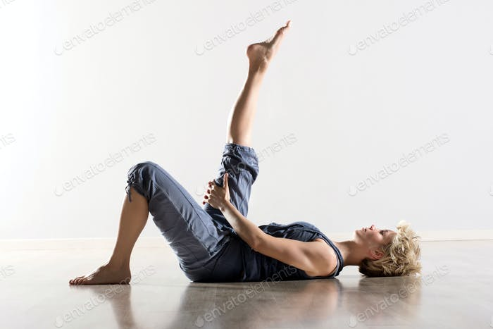 Woman on back stretching hamstring muscles