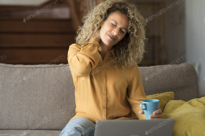 Tired young woman touch stiff neck feeling hurt joint back pain rubbing massaging tensed muscles