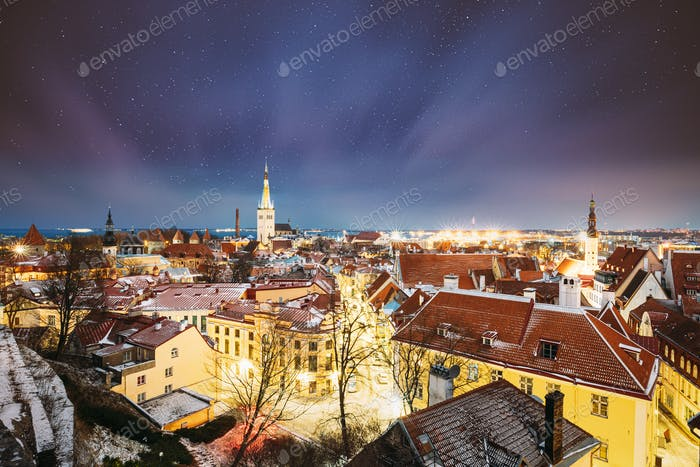 Tallinn, Estonia. Night Starry Sky Above Traditional Old Architecture Cityscape Skyline In Old Town