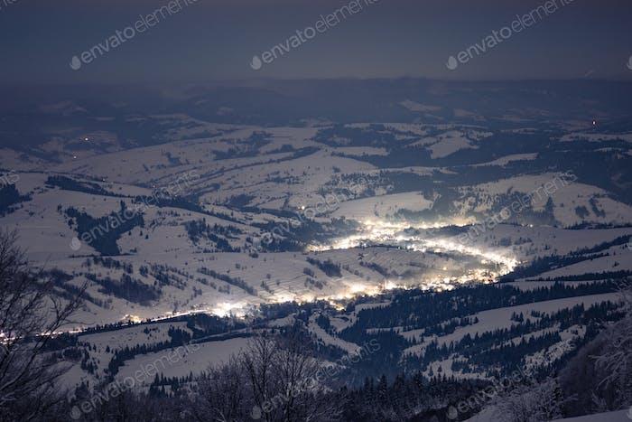 Night village in winter time lapse in Carpathian Mountains