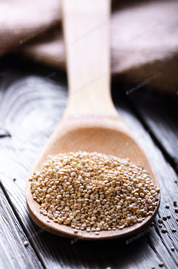 Raw organic superfood gluten free quinoa seeds in wooden spoon o