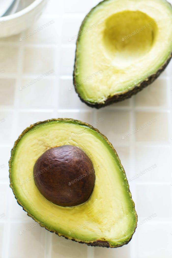 Sliced organic avocado on the kitchen table