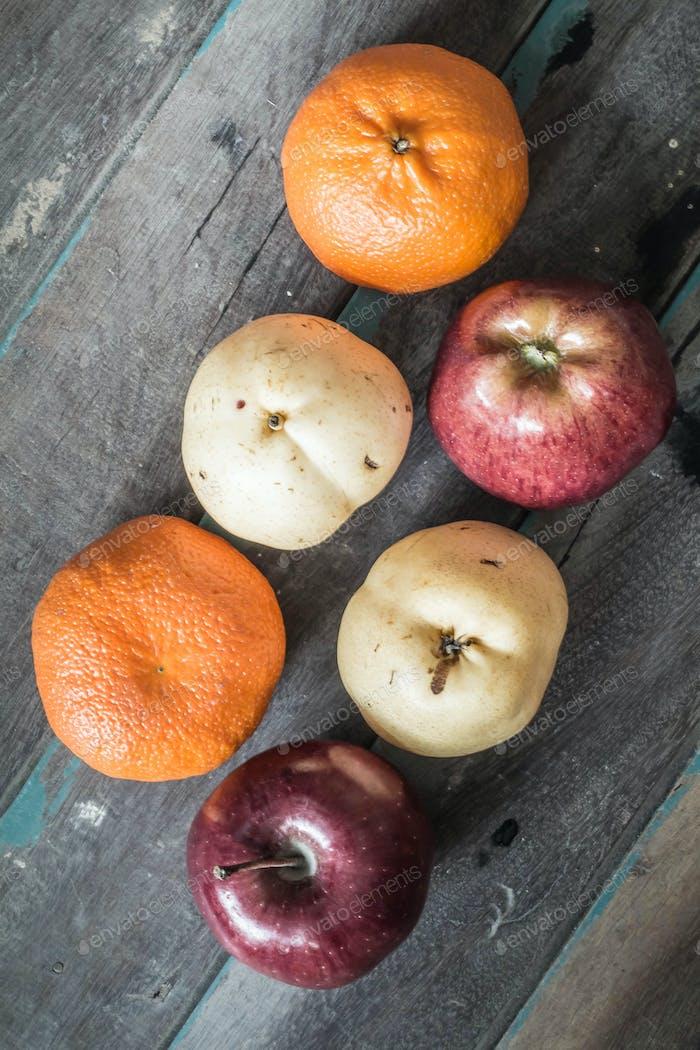 Assorted fruit on wood