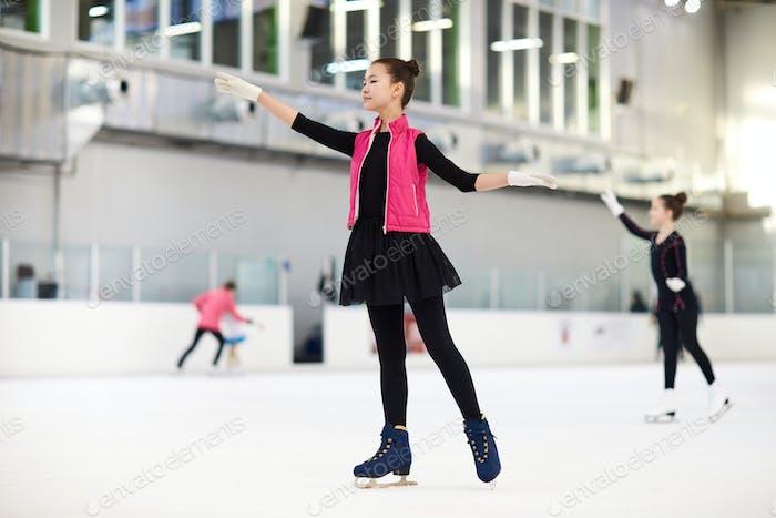 Teenage Asian Girl Figure Skating