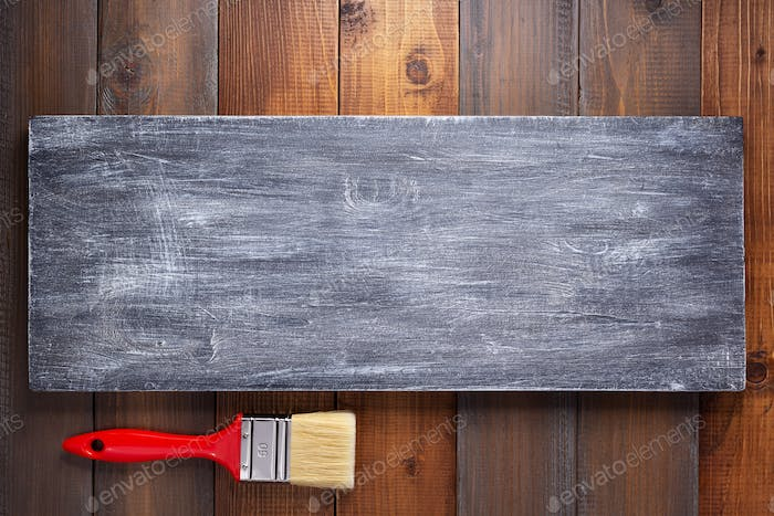 wooden plank board and paint brush