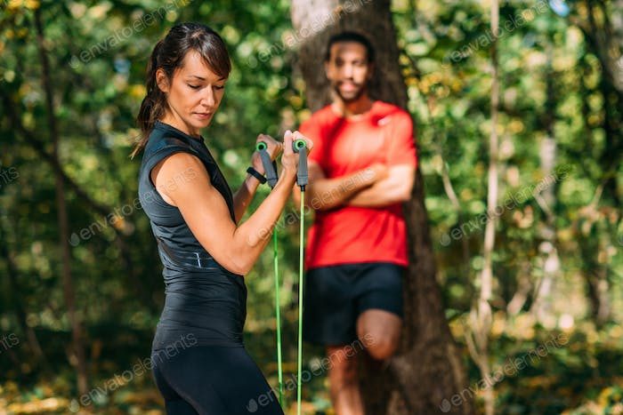 Young Couple Exercising with Elastic Resistance Band