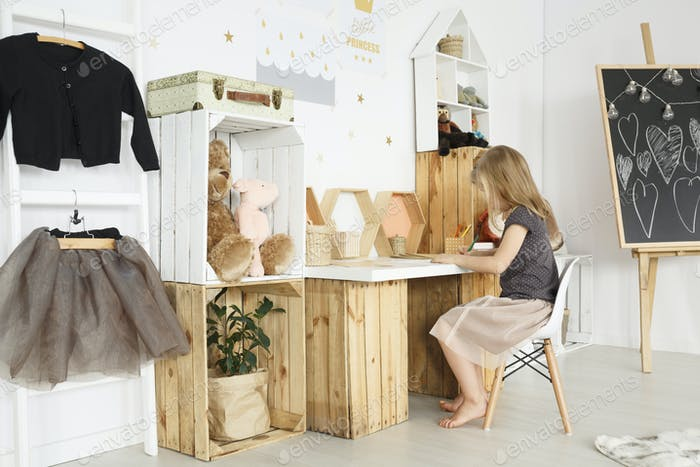Girl sitting at a desk in cozy room