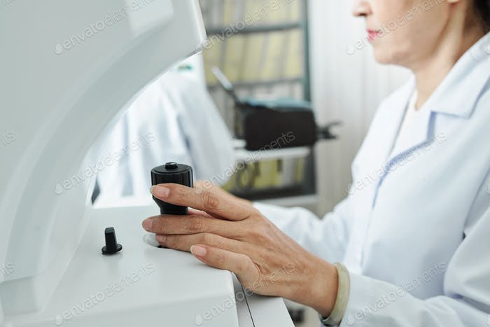 Doctor using medical equipment at work
