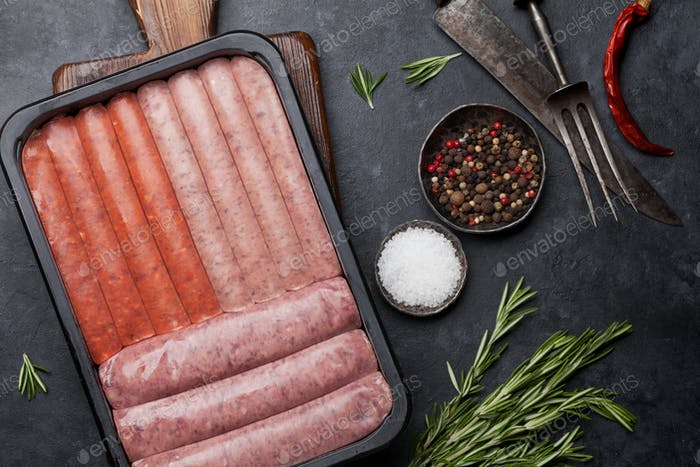 Raw sausages cooking