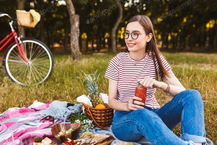 Beautiful smiling girl in eyeglasses and striped t-shirt dreamil