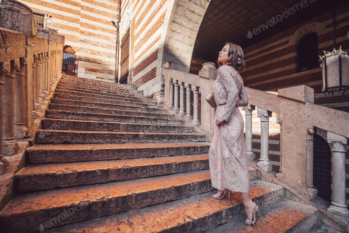 Attractive girl climbing stairs