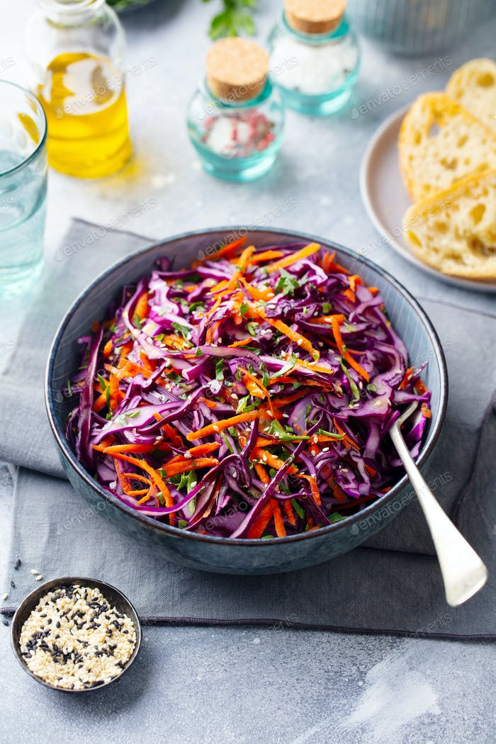 Red Cabbage Salad. Coleslaw in a Bowl. Grey Background.