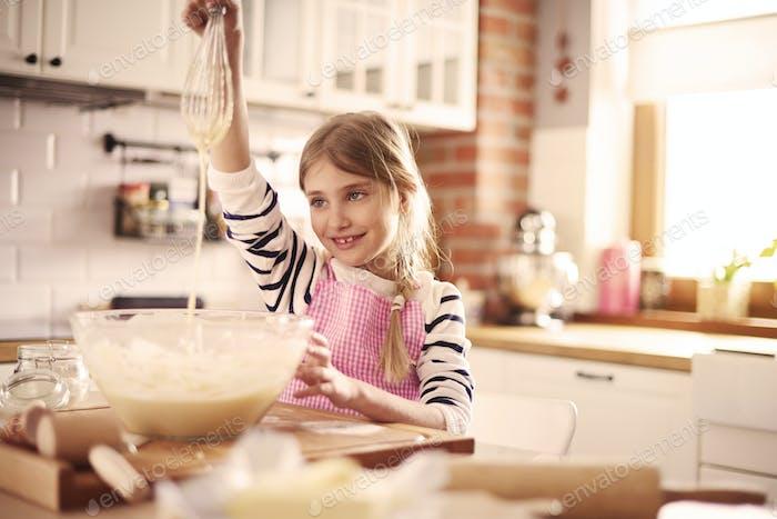 Top view of girl preparing dough