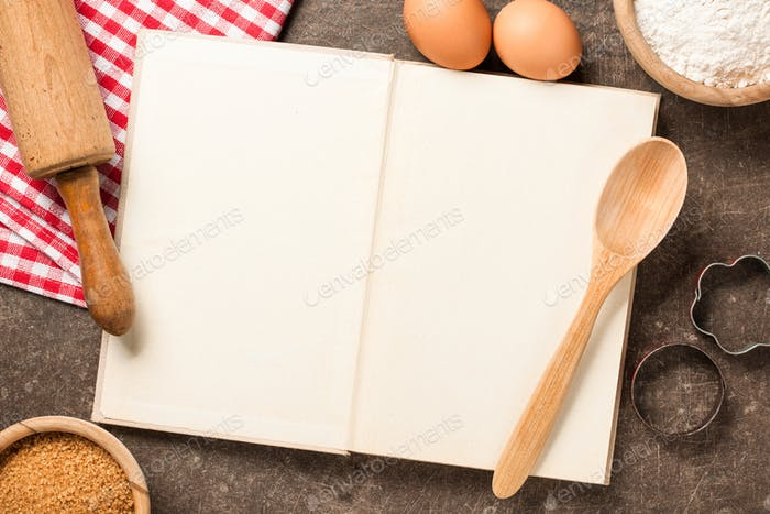 Baking concept with cookbook and ingredients