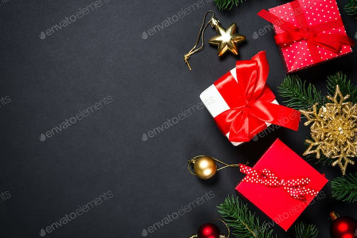 Christmas background with decorations on black