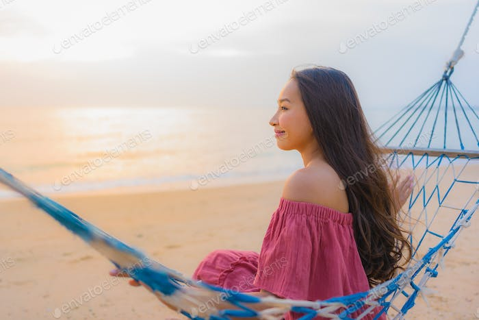 Portrait beautiful young asian woman sitting on the hammock with