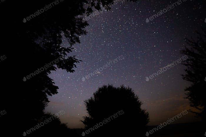 Beautiful night sky with Milky Way and falling stars