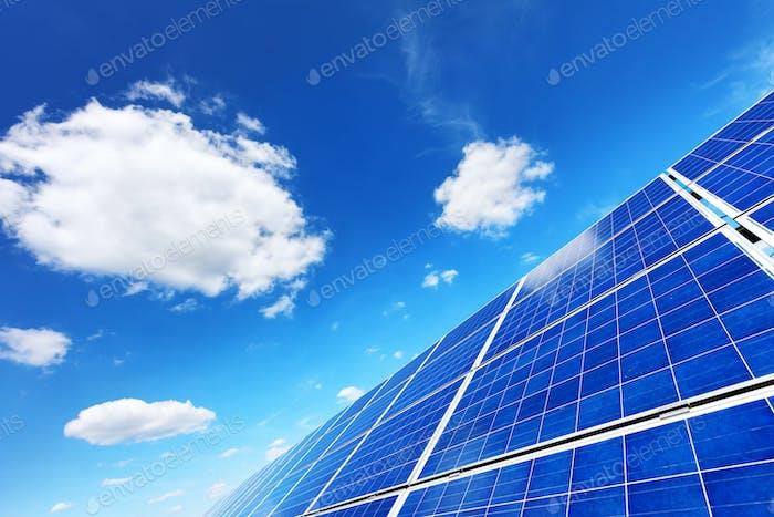 Solar panel on blue sky background