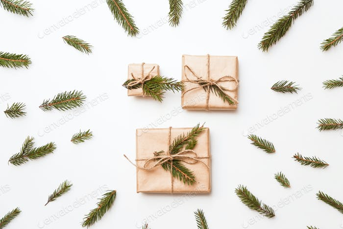 Christmas composition. Christmas gift, word winter made of fir branches. Flat lay, top view