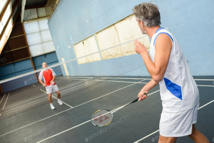 Men playing badminton