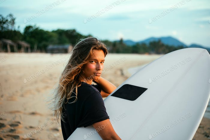 Surfer girl on beach