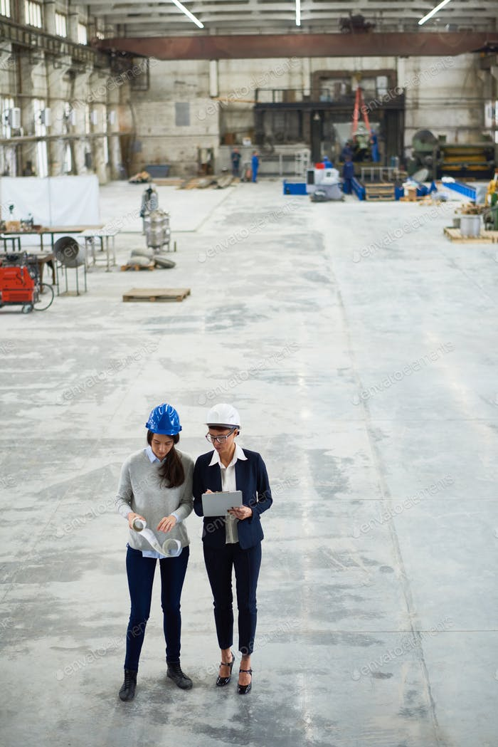 Giving Tour of Modern Factory