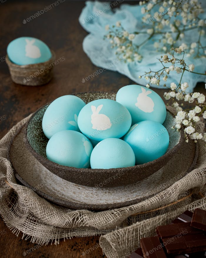 Unusual Easter on dark old background. Concept of new life, rebirth. Rustic style.