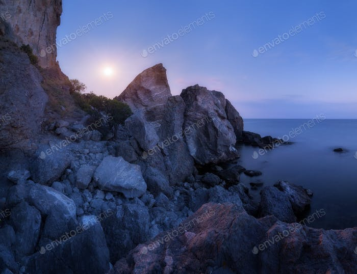 Mountain landscape on the sea at night