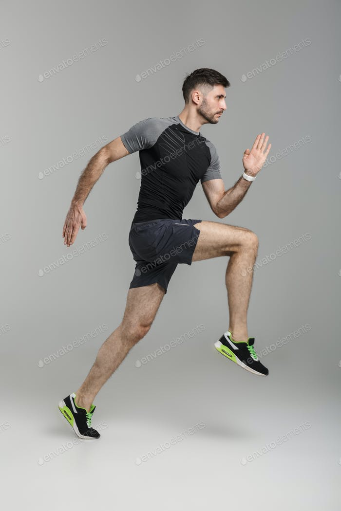 Image of young athletic man in sportswear running while working out