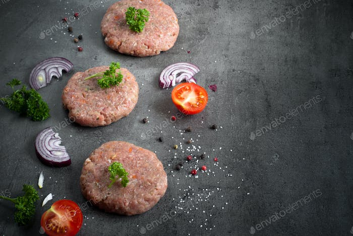 Raw burgers and ingredients