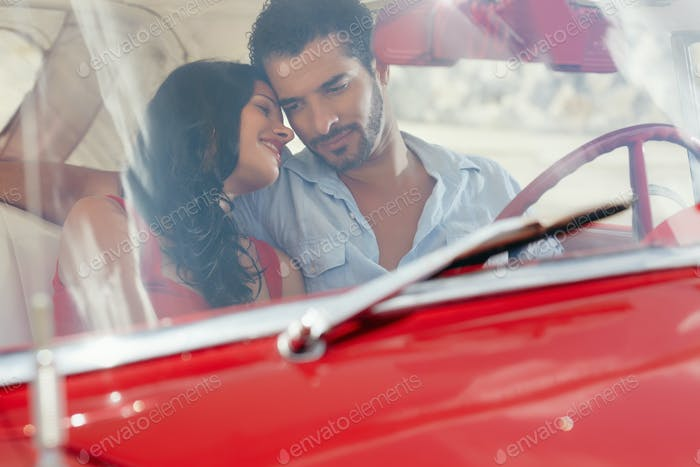 Girlfriend And Boyfriend Flirting In Red Old Car