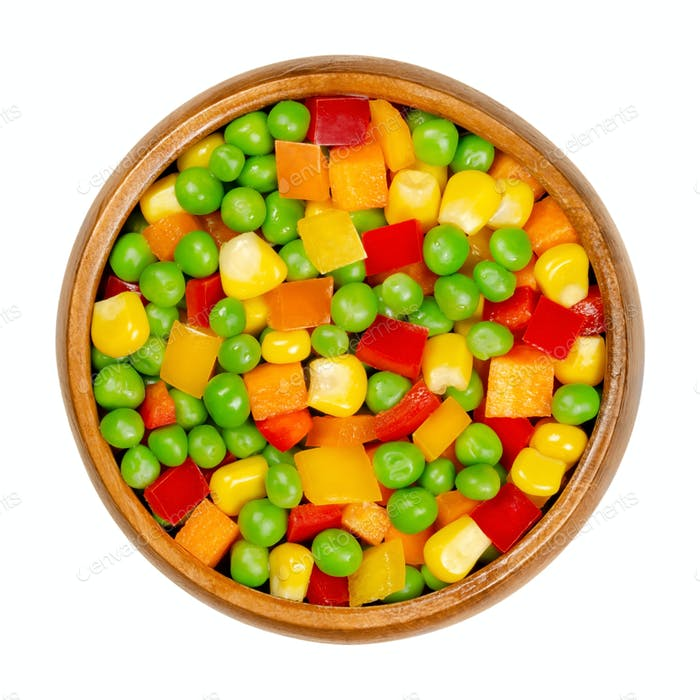 Mixed vegetables, veggie mix in a wooden bowl