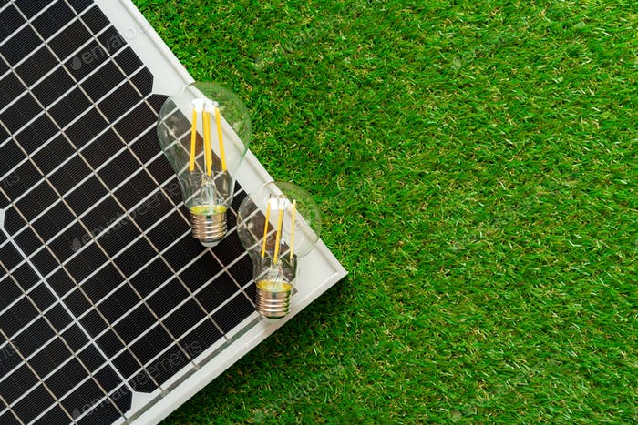 Solar energy panel and light bulb, green energy