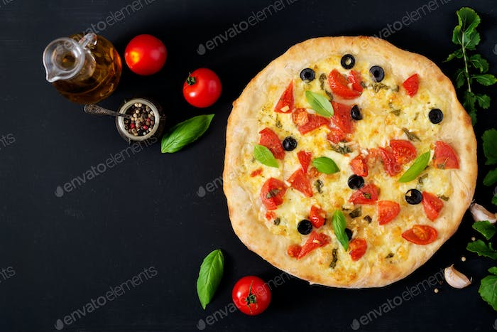 Pizza with tomato, mozzarella, basil and olives. Top view