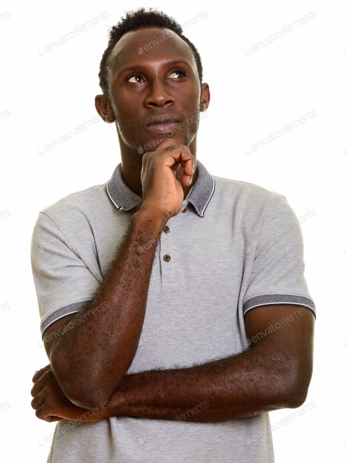 Young black African man thinking while looking up