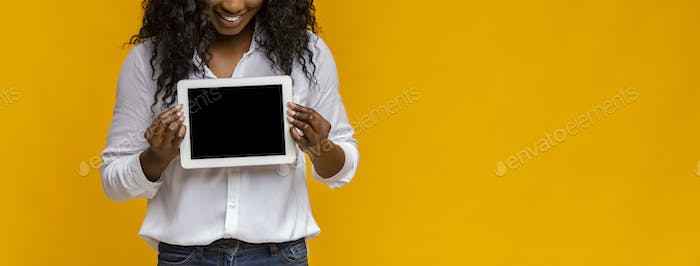 Cropped image of black girl showing empty digital tablet screen