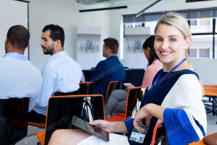 Businesswoman looking at camera in a office