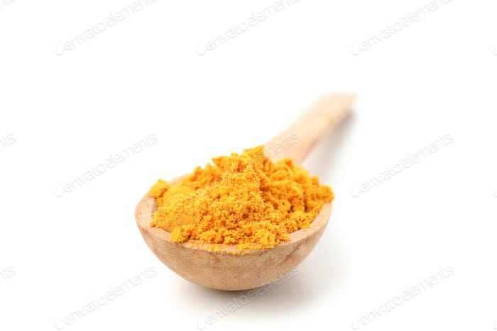Wooden spoon with turmeric powder isolated on white background, close up