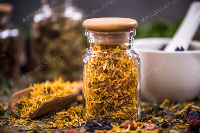 Tea with dried flowers and fruits in jar