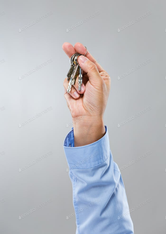 Businessman hand hold with key