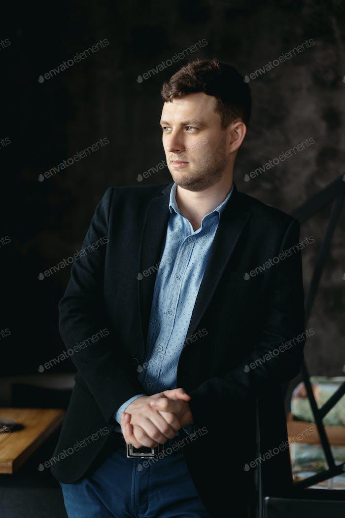 Man portrait posing in a loft modern space