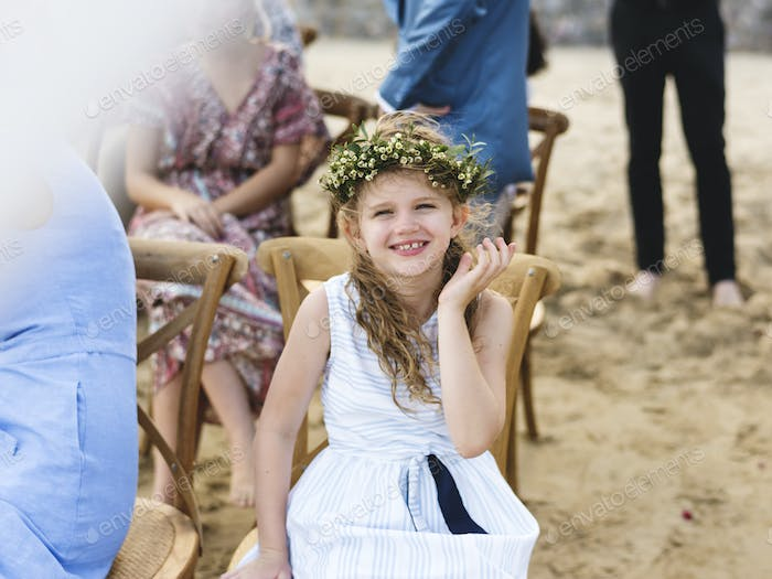 Little bridesmaid at a beach wedding