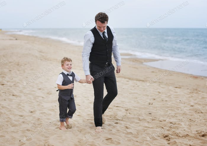 Father and son at a beach wedding