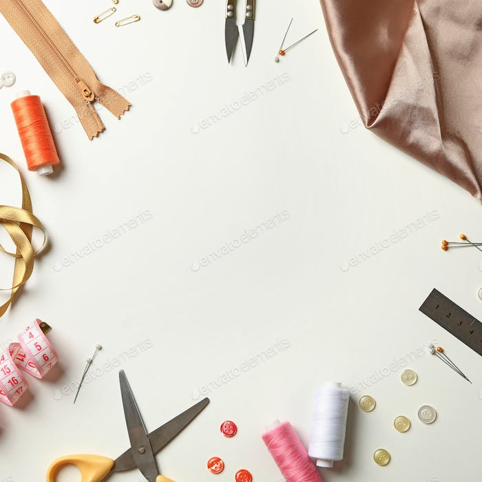 Sewing supplies on white background, space for text