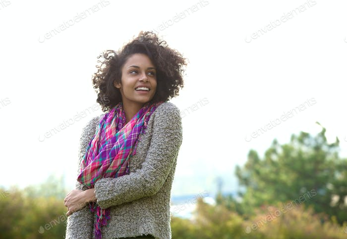 Smiling young african american woman standing outdoors